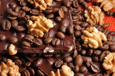 Black chocolate with coffee bens and nuts — Stock Photo