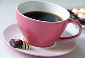 Coffee with chocolate hearts — Stock Photo
