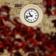 Clock on stone wall - Stock Photo