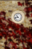 Clock on stone wall — Stock Photo