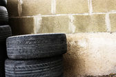 Tires against the wall — Stock Photo