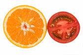 Orange and tomato — Stock Photo