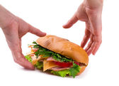 Sandwich with a ham, paprika and cheese in hands isolated — Stockfoto