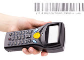 Electronic manual scanner of bar codes in woman hand — Stock Photo
