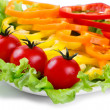 Mix of fresh vegetables, colored paprika, tomatoes on leaves of green salad — Foto Stock