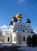 Christian orthodox church with brilliant domes against the blue sky in the — Stock Photo