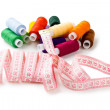 Stock Photo: Spools Multi-colored threads randomly with measuring tape of tailor