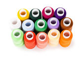 Spools multi-colored threads standing group isolated on a white background — Stock Photo