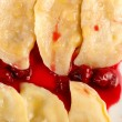 Ukrainian national dish varenyky (ravioli) with cherry closeup - Stock Photo