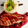 Chicken grill with rice and cherry sauce - Stock Photo