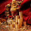 Laughing Budda with golden coins — Stock Photo