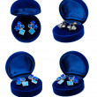 Stock Photo: Earring in blue present box