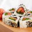 图库照片: Sushi rolls with tuna and green onion