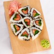 Foto Stock: Sushi rolls with tuna and green onion