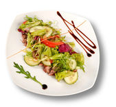 A plate of pork with vegetables. File includes clipping path for — Stock Photo