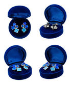 Earring in blue present box — Stock Photo