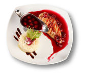Delicious beef with cherry sauce. File includes clipping path — Stock Photo