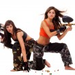 Girls playing paintball - Stock Photo