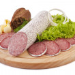 Royalty-Free Stock Photo: Sliced sausage with bread, butter and vegetables