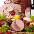 A composition of meat and vegetables with wine — Stock Photo