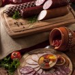 A composition of different sorts of sausages — Stock Photo