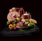 A composition of meat and vegetables with beer — Stock Photo