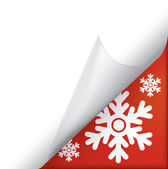 Snowflakes page curled corner — Stock Vector