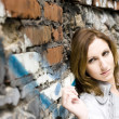 Stock Photo: Pretty Woman Near Graffiti Wall