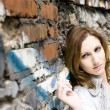 Pretty Woman Near Graffiti Wall — Stock Photo