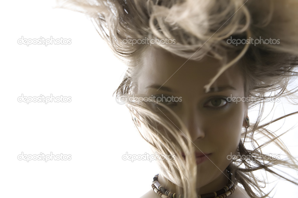 Blond Woman Dancing. Focus on the hair.  Stock Photo #4830907