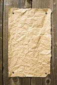 Old Paper On Dark Wooden Texture — Stock Photo
