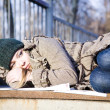 The Young Woman Lying On Asphalt - Stock Photo