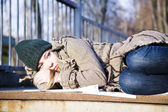 The Young Woman Lying On Asphalt — Stock Photo