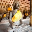 Ancient Buddha sculpture - Stock Photo