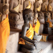 Ancient Buddha sculptures - Stock Photo