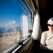 Woman Looking Through Window — Stock Photo