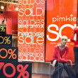 Стоковое фото: Shop Window With Sale Banners