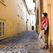 Young Woman Walking In Old City — Stock Photo