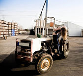 Woman On A Tractor — Stock Photo