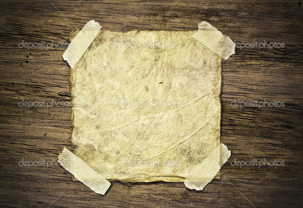 Old paper on wood background  Stock Photo #5311926