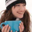 The girl smiles and holding a blue cup - Stock Photo