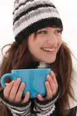 The girl smiles and holding a blue cup — Stock Photo