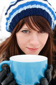 Girl holding a cup — Stock Photo