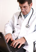 Doctor and laptop — Stock Photo