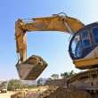 Back hoe vehicle on pile of dirt — Stock Photo #4928619