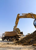The dredge and the dumper truck — Stock Photo