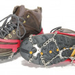 Hiking Boots with ice cleats or crampons — ストック写真
