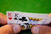 Pocket kings hand — Stock Photo