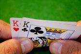 Pocket kings hand — Stock Photo