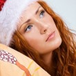 Beauty red woman in santa hat — Stock Photo
